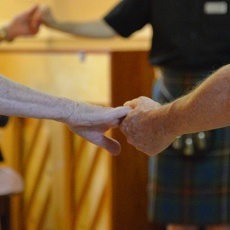 Scottish country dancers holding hands